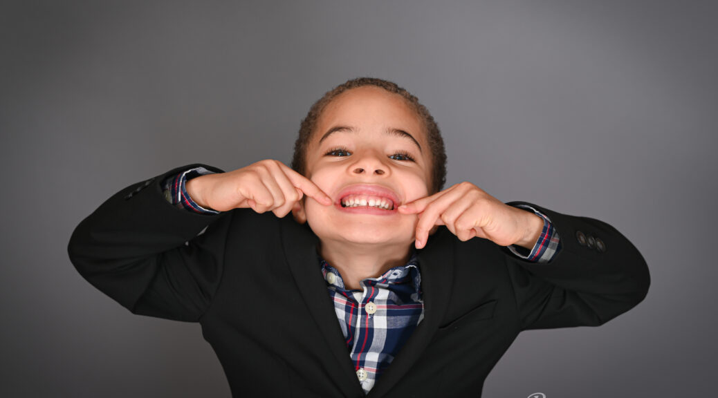 Young black boy with a huge smile