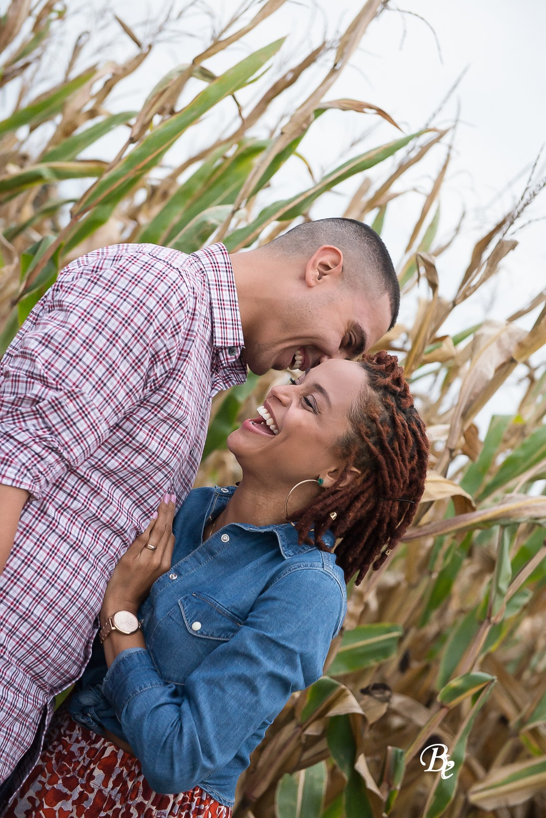 Laughing couple in a cornfield